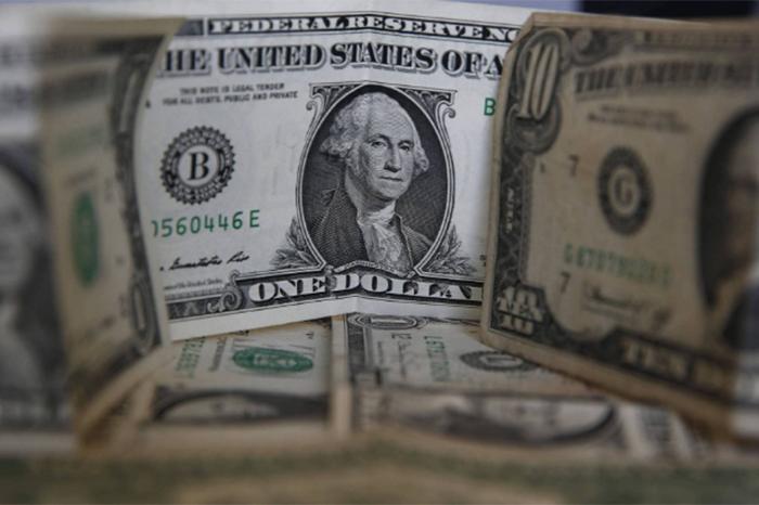 Foto: Agencias. El billete verde se ofrece en un precio máximo de 21.50 pesos y se adquiere a un mínimo costo de 20.40 pesos.