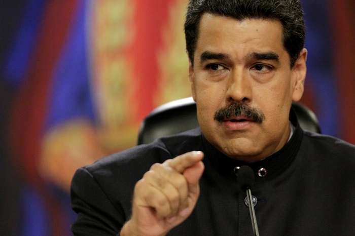 FILE PHOTO: Venezuela's President Maduro talks to the media during a news conference at Miraflores Palace in Caracas