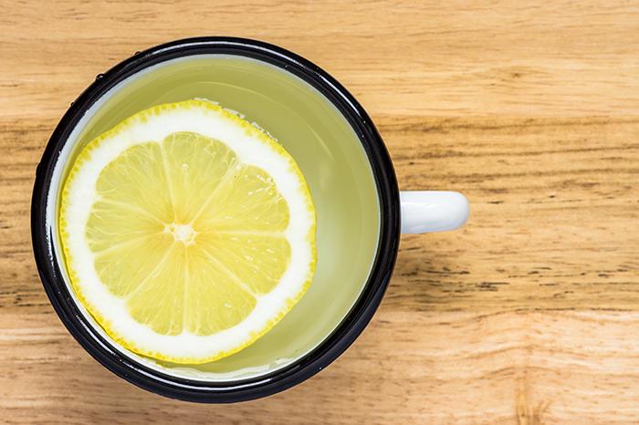 Water with lemon in a steel mug